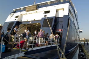 Tourists boarding the ferry boat at the port of Piraeus this week.