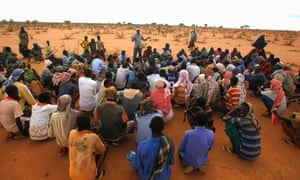 A UNHCR worker briefs Somali refugees about camp layout at UNHCR's Ifo extension camp outside Dadaab, eastern Kenya.