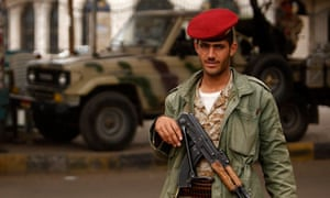 Yemen army trooper looks on, while manning a checkpoint in Sanaa