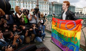 Gay rights activist Kirill Kalugin poses for press during a one-man protest in St. Petersburg