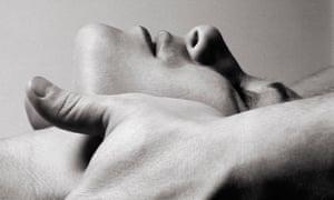 Woman's head held in carer's hands