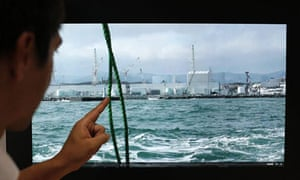 A University of Tokyo scientist shows a video of the Fukushima nuclear power station