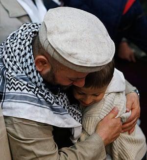 Eid festival: A Muslim man embraces his son