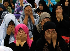 Eid festival: Muslim women attend a prayer session to celebrate Eid al-Fitr in Manila