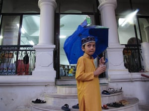 Eid festival: A young boy leaves Hanoi's only mosque