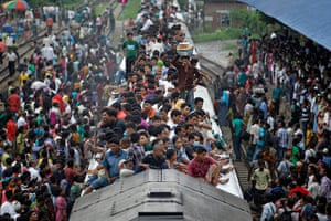 Eid festival: Passengers sit on the top of an overcrowded train