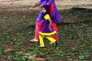 Eid festival: A Muslim girl walks with her mother