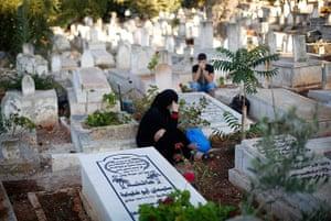 Eid festival: Palestinians sit next to graves