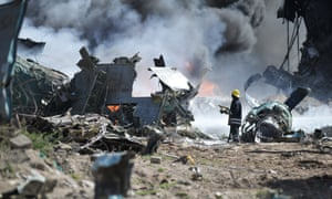 Firefighters attempting to stop the fire at the site of an plane crash in Mogadishu, Somalia. An Ethiopian Air Force aircraft crashed on landing this morning at Mogadishu's Aden Adde International Airport. Two of the six crew members survived the crash.