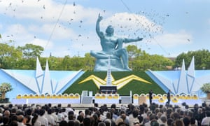 Doves fly over the Peace Statue at the Peace Momorial Park in Nagasaki, as the city marks the anniversary of the bombing.