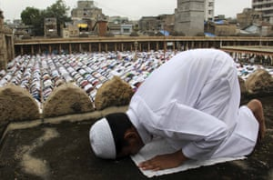 Praying alongside many others, a boy at the Jama mosque in Ahmedabad, India.