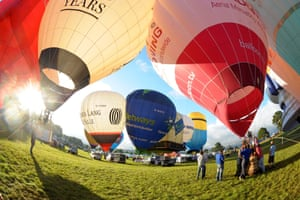 A fisheye lens photo of balloons preparing for takeoff at Ashton Court in Bristol during the Bristol International Balloon Fiesta. The yearly meeting sees balloonists from all over the world gather at what is the largest balloon event in Europe. Photograph: Tim Ireland/PA