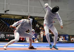 En Garde: Hong Kong's Siu Lun Cheung (L) fights with Japan's Ryo Miyake (R) during the men's individual foil fencing qualification round at the 2013 World Fencing Championships in Budapest, Hungary. Photograph: Attila Kisbenedek/AFP/Getty Images