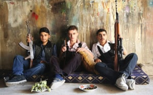 Young Free Syrian Army fighters pose for a picture in Jobar, Damascus.