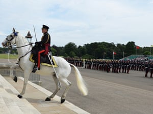 In an old tradition, Academy Adjutant Major Dai Bevan riding his horse Winston up the front steps during the Sovereign's Parade at the Royal Military Academy, Sandhurst.