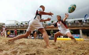 Competitors from Incentive FM Group (L) and Jones Lang LaSalle play in a Beach Rugby tournament in Covent Garden in London. The two-day tournament features competitors from the corporate sector and traditional rugby clubs and is raising funds for Restart, the official charity of the Rugby Players' Association. Photograph: Suzanne Plunkett/Reuters