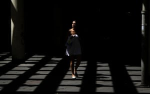 A woman passes through a corridor in Belgrade, Serbia. Temperatures have hit the 40 degree Celsius (104 Fahrenheit) mark as a stubborn heatwave nears the end of its second week in the Balkans. Photograph: Marko Drobnjakovic/AP