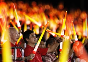 May the force be with you: Singapore's former Prime Minister Lee Kuan Yew (L) waves a light stick during Singapore's national day parade celebrations. The city state celebrates 48 years of independence. Photograph: Edgar Su/Reuters