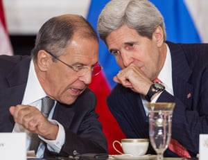 Diplomatic whispers: Russian Foreign Minister Sergey Lavrov (L) and US Secretary of State John Kerry speak as remarks are delivered to the media while meeting with US Secretary of Defense Chuck Hagel, Russian Defense Minister Sergey Shoygu at the US Department of State in Washington, DC. Photograph: Paul J. Richards/AFP/Getty Images