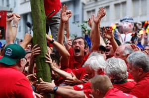 Members of the Meyboom brotherhood plant the Meyboom tree in central Brussels, Belgium. The Meyboom was planted for the 705th time and celebrates the 1213 victory of Brussels over the neighbouring city of Leuven in a battle over a beer tax. Photograph: Yves Herman/Reuters