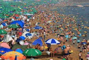 Tourists cool off at a beach in Dalian City, northeast China's Liaoning Province. The scorching weather continues in most parts of China. Photograph: Wang Hua/Xinhua Press/Corbis