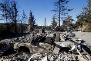 The remains of a home and a car destroyed by a wildfire are seen near Banning. Southern California firefighters are facing another day of battle as they try to corral a wildfire that has destroyed 26 homes. Photograph: Jae C. Hong/AP