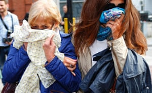 Ann (L) and Daniela Skinner, the wife and daughter of Domenico Rancadore, cover their faces as they leave Westminster Magistrates' Court in London. Rancadore, a senior member of an Italian mafia clan, wanted by the Italian authorities for almost 20 years, who assumed the name Marc Skinner whilst living in Britain, appeared at court after being detained under a European arrest warrant. Photograph: Andrew Winning/Reuters