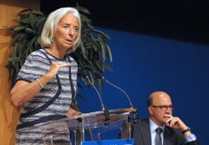 French Finance Minister Pierre Moscovici listens as International Monetary Fund (IMF) Managing Director Christine Lagarde addresses a joint IMF-Treasury seminar at the Economy Ministry in Paris on September 10, 2013 .