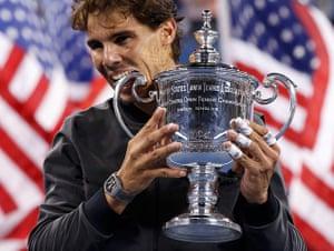 tennis: Nadal of Spain bites his trophy