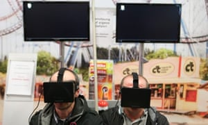 Visitors use Oculus Rift virtual reality headsets at the IFA Electronics Trade Fair in Berlin.