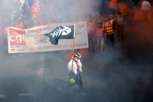 People march as part of a nationwide day of protest against the government's plans to reform France's debt-ridden pension system, on September 10, 2013 in Marseille, southern France.