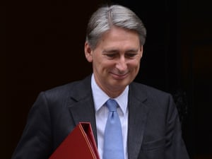 Defence Secretary Philip Hammond leaves 10 Downing Street in London after attending a cabinet meeting with the prime minister.