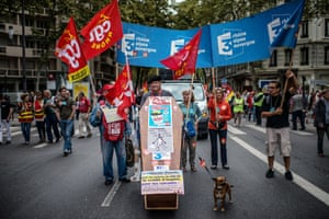 People march with a coffin as part of a nationwide day of protest against the government's plans to reform France's debt-ridden pension system, on September 10, 2013 in Lyon.