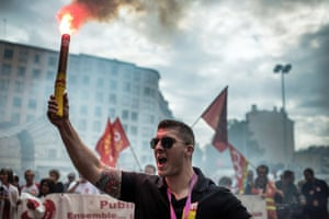 People march as part of a nationwide day of protest against the government's plans to reform France's debt-ridden pension system, on September 10, 2013 in Lyon.