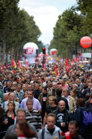 People march as part of a nationwide day of protest against the government's plans to reform France's debt-ridden pension system, on September 10, 2013 in Paris.