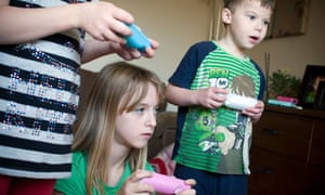 Children playing on video games
