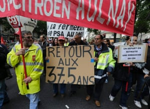 "Employees of PSA Peugeot Citroen Aulnay-sous-Bois automotive plant demonstrate over pension reforms in Paris, September 10, 2013. French unions take to the streets on Tuesday in protest against a reform of the country's indebted pension system, with some disruption in transport expected but no mass upheaval against an overhaul seen as moderate in scope. The placard reads ""Back to the 37,5 years""."