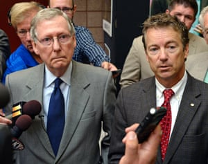 In this Aug. 22, 2013 file photo, Senate Minority Leader Mitch McConnell of Ky., left, and Sen. Rand Paul, R-Ky. speak with reporters following their appearance at the 50th annual Kentucky Country Ham Breakfast at the Kentucky State Fairgrounds in Louisville, Ky.(AP Photo/Timothy D. Easley, File)