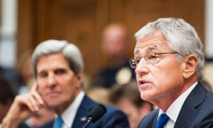 Secretary of State JOHN KERRY looks on as Secretary of Defense CHUCK HAGEL testifies before the House Armed Services Committee on Capitol Hill on the situation in Syria.