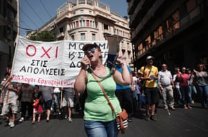 University employees and professors shout slogans during a rally over job layoffs, transfers and department closing in central Athens September 10, 2013.