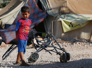 A Syrian refugee child who arrived with his family from Damascus, plays at the Majdal Anjar refugee camp in Bekaa Valley near the Syrian border in eastern Lebanon, September 9, 2013.