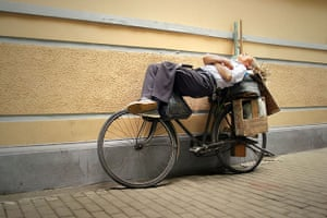 Big Picture - Daydreamers: man lying on bicycle sleeping