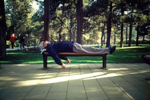 Big Picture - Daydreamers: man lying on bench in park sleeping