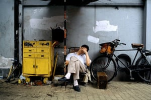 Big Picture - Daydreamers: Man lying on deckchair next to bicycle