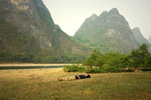 Big Picture - Daydreamers: Man lying on grass sleeping