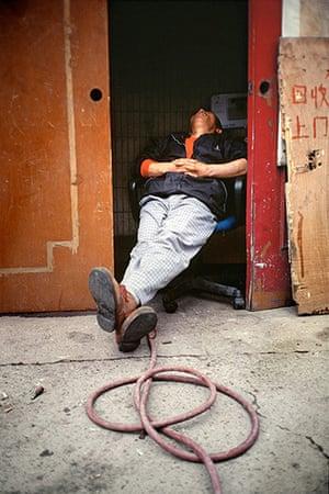 Big Picture - Daydreamers: Man sleeping inside doorway
