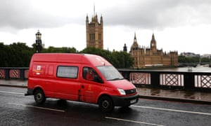 A Royal Mail van crosses Lambeth Bridge with the Houses of Parliament behind it, in central London, September 12, 2013.