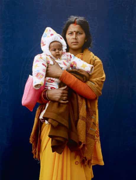 Kumbh Mela pilgrim Mamta Dubey and infant  by Giles Price