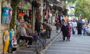 People walk at a street in old Damascus, September 12, 2013. REUTERS/Khaled al-Hariri