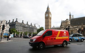 A Royal Mail passes the Houses of Parliament behind it, in central London, September 12, 2013.